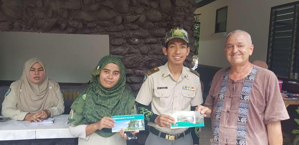 National park staff hands over the brochure of Budo Sungai Padi National park to Frans Betgem South Thailand