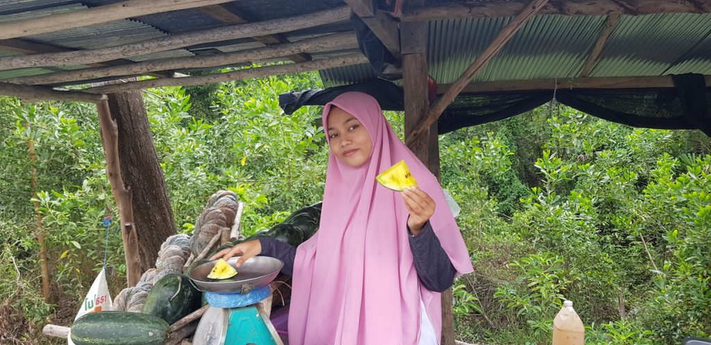 Muslim girl with watermelon