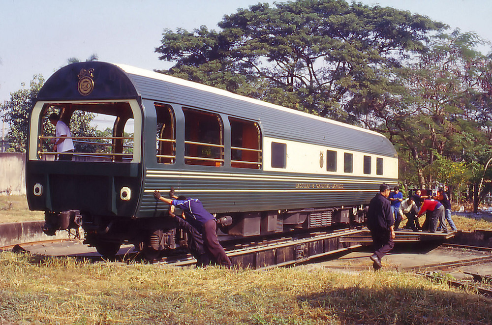 Staff pushing a train carriage on a turntable