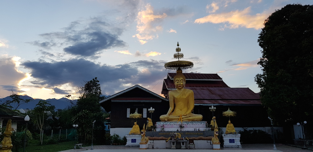 Sunset at the Buddha statue of Wat Klang in downtown Pai