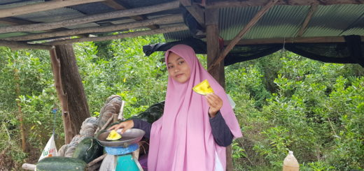 Muslim girl selling watermelon near Pattani. There is a negative travel advisory for Pattani.