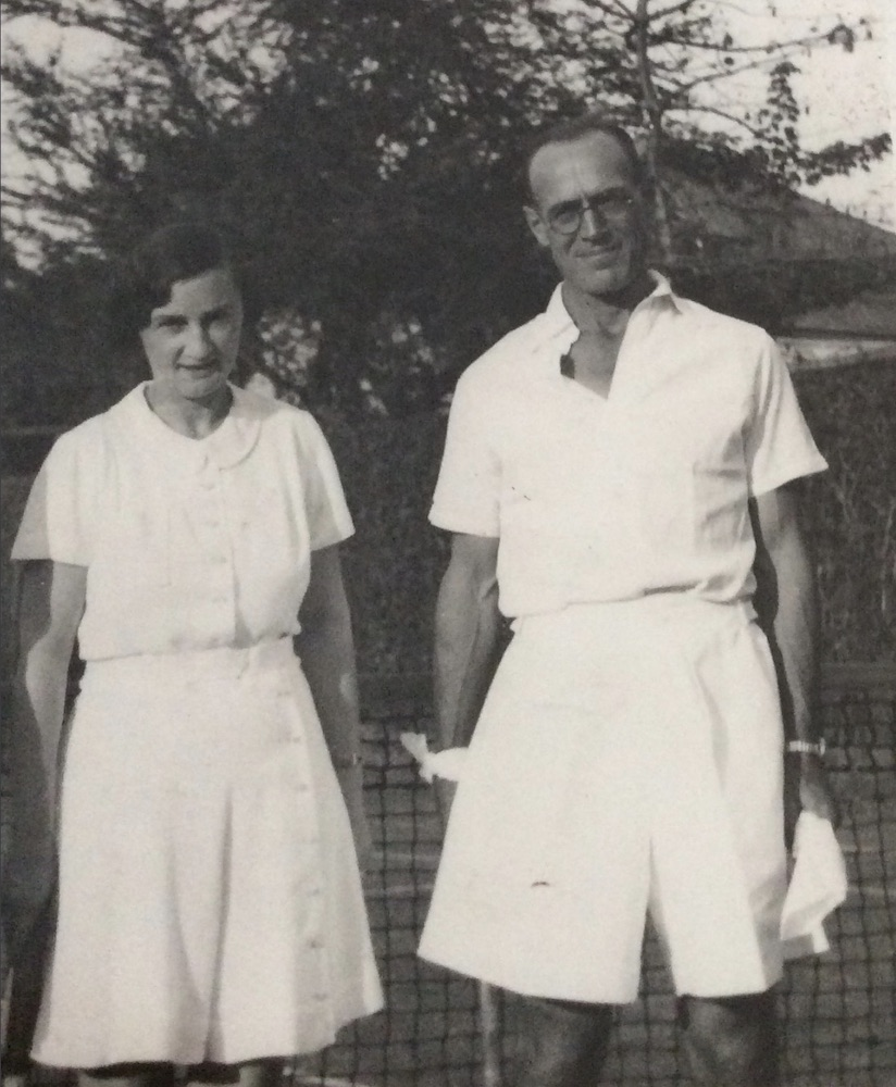 Man and woman in tennis clothes