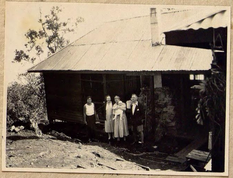 Group of people in front of house