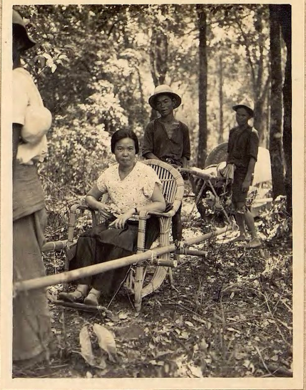 woman in chair with porters